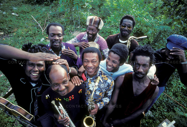 """The Black Disciples, Burning Spear's band. Top L to R: Vin Gordon, Noel """"Zoot"""" or """"Scully"""" Simms, Richard """"Dirty Harry"""" Hall, Earl """"Chinna"""" Smith; bottom L to R: Robbie Shakespeare, Bobby Ellis, Herman Marquis, Bernard Harvie, Leroy """"Horsemouth"""" Wallace. Ocho Rios, Jamaica. March 1976"""